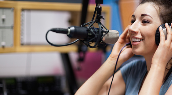 Cute-radio-host-speaking-throu-23781929